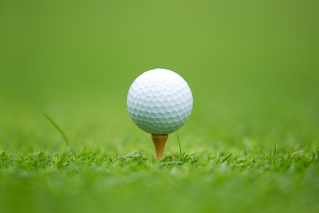 tee: A close-up of a Golf ball sitting on a tee Stock Photo