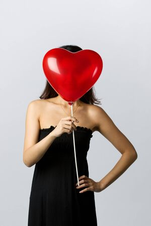 Valentines day image of a young Asian woman photo