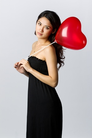 Asian Woman holding a gift for Valentines Day Stock Photo - 11599423