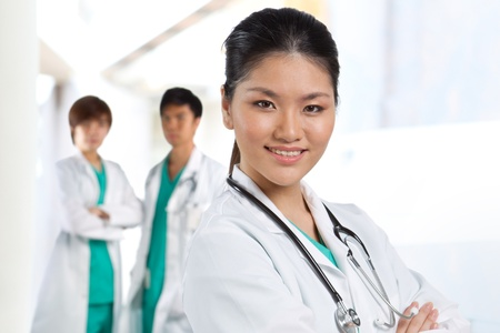 white coat: Asian Male doctor wearing a white coat and stethoscope. Stock Photo