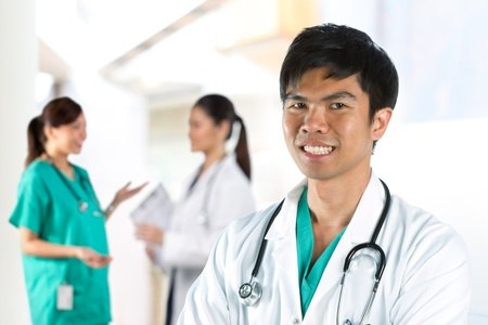 Asian Male doctor wearing a white coat and stethoscope. Stock Photo - 11701965