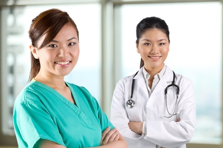 Two female Asian doctors looking at the camera. Stock Photo - 12245658