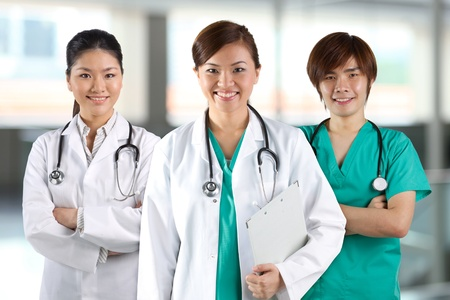 Three Asian doctor wearing a white coats with stethoscope's. Stock Photo - 12244717