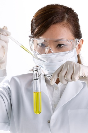 A female scientific researcher looking at a liquid solution. Stock Photo - 12245648