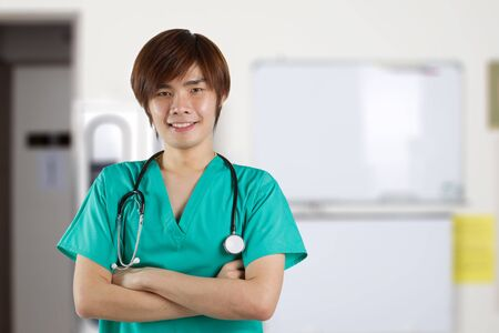 Asian Male doctor wearing a green scrubs and stethoscope. Stock Photo - 12249849