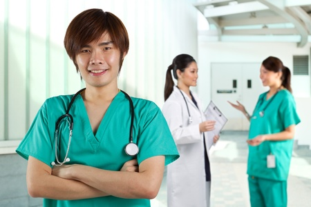 Asian Male doctor wearing a green scrubs and stethoscope. photo