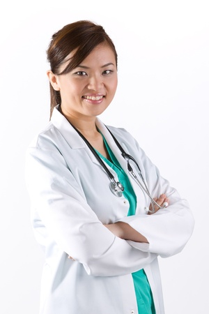 asian doctor: Female Asian doctor wearing a white coat and stethoscope. Isolated on white. Stock Photo