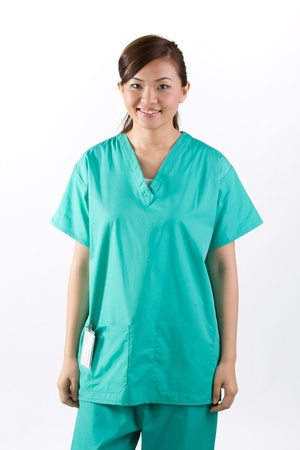 nursing staff: Female Asian doctor wearing a green scrubs. Isolated on white. Stock Photo