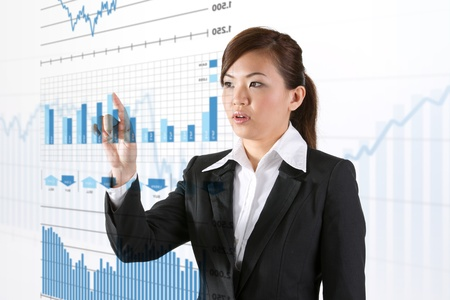 Asian business woman touching a business chart on screen photo