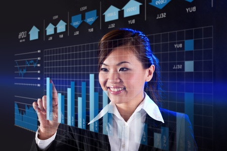 touch technology: Asian business woman touching a business chart on screen