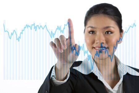 Asian business woman touching a business chart on screen Stock Photo - 12245759