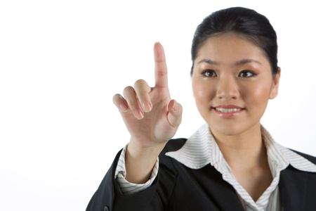 Asian business woman touching a virtual screen photo