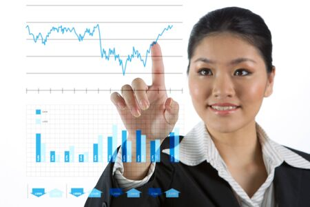 Asian business woman touching a business chart on screen
