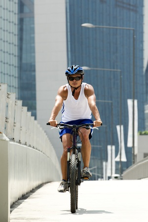 sporting activity: Asian male Cyclist sitting on a bike