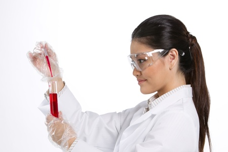A female scientific researcher looking at a liquid solution. Stock Photo - 12595946