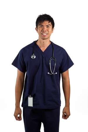 Portrait of a happy Asian nurse or doctor. Isolated on a white background. photo