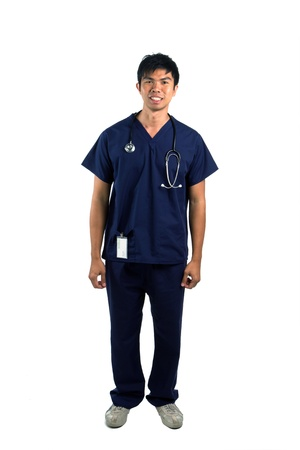 Full length portrait of a happy young Asian nurse or doctor. Isolated on a white background. photo