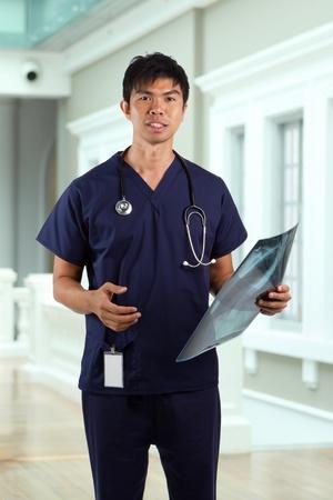 asian nurse: Asian healthcare worker holding an X-ray