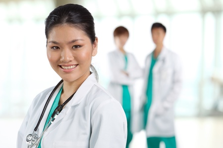 Female doctor with colleague in the background out of focus. photo