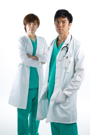 Two male Asian doctors wearing a scrubs and stethoscope. photo