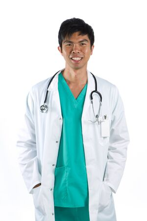 Asian doctor wearing a green scrubs, a white coat with stethoscope.  Stock Photo - 12596545