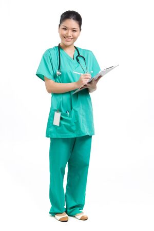 Female Asian doctor wearing a green Scrubs and stethoscope. Isolated on white. Full length Portrait. photo