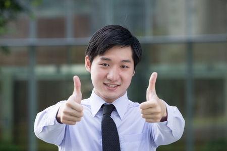 Happy Asian business man with both thumbs  photo