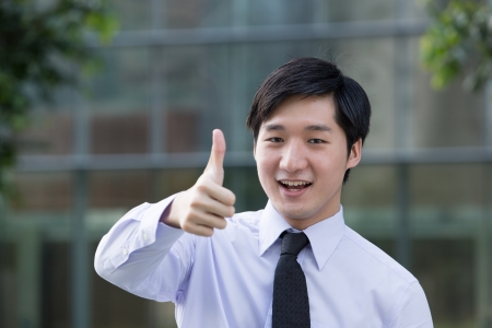 both: Happy Asian business man with both thumbs