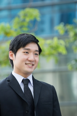 Portrait of an Asian business man in looking away from camera.   photo