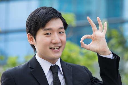 Portrait of an Asian business man gesturing OK Stock Photo - 13194315