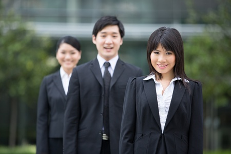 Group of happy Asian business people standing in row. Stock Photo - 13194294