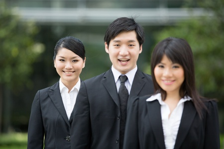 Group of happy Asian business people standing in row. Stock Photo - 13194295