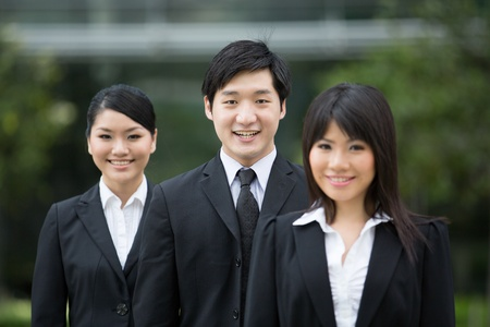 Group of happy Asian business people standing in row. Stock Photo - 13194299