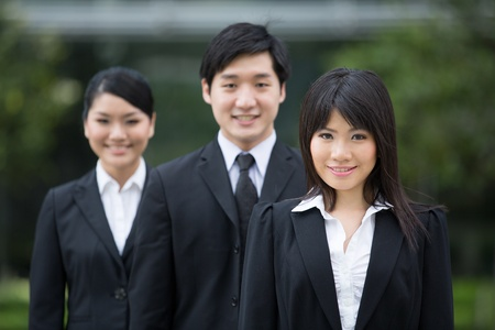 Group of happy Asian business people standing in row. Stock Photo - 13194297