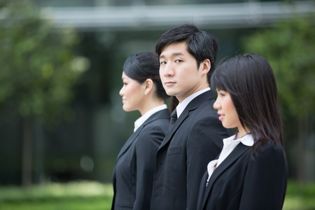 Group of happy Asian business people standing in row. Stock Photo - 13194337
