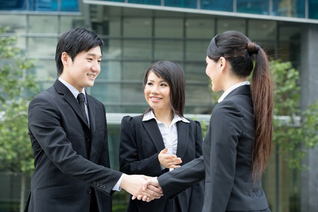 Asian business man and woman shaking hands. Stock Photo - 13194350