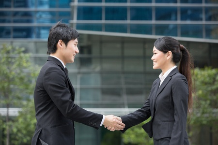 Asian business man and woman shaking hands. Stock Photo - 13236205