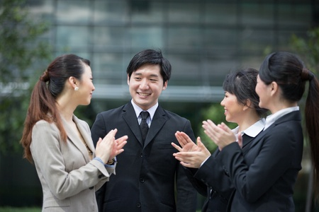Business leader applauds with there team. Stock Photo - 13194320