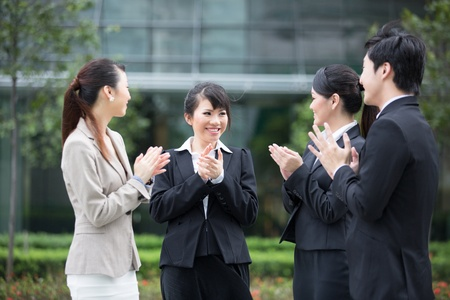 Business leader applauds with there team. photo