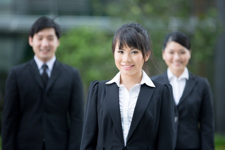 Group of happy Asian business people standing in row. Stock Photo - 13194310
