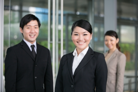 Happy Asian business team standing together with there leader. Stock Photo - 13194409