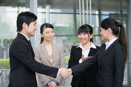 Asian business man and woman shaking hands. Stock Photo - 13194396
