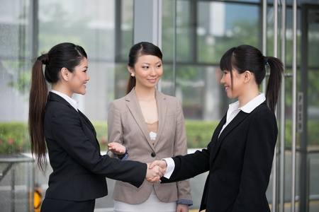 Asian business women shaking hands. photo