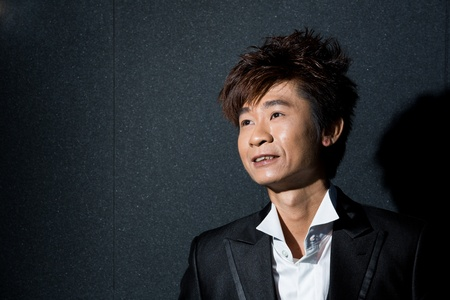 Trendy Asian man posing. Wearing a tuxedo and waistcoat. Stock Photo - 13194249