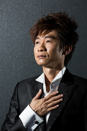 black business men: Trendy Asian man posing. Wearing a tuxedo and waistcoat.