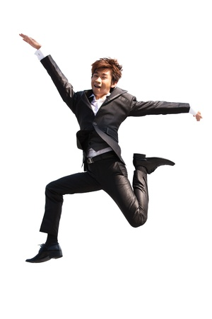 Asian business man jumping while wearing a suit. photo