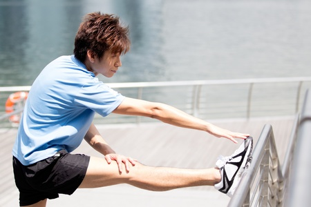 Asian man stretching before going for a run. Stock Photo - 13326862