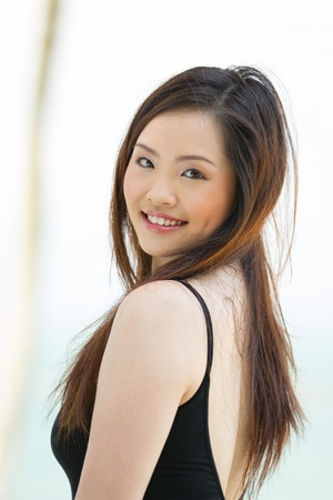 sexy asian woman: A young and happy Asian lady standing outside. Stock Photo