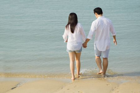 Young Asian couple in love on the beach.  photo