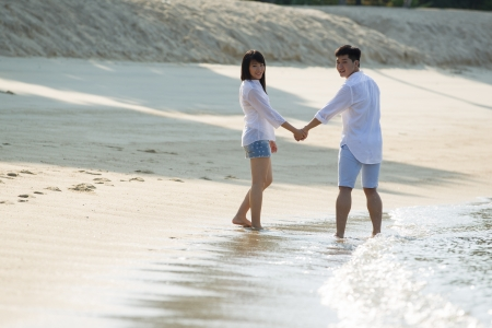 Young Asian couple in love on the beach. Stock Photo - 13666373